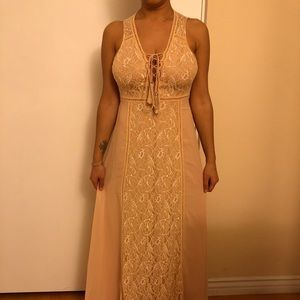 A beautiful long cream dress, special occasions.